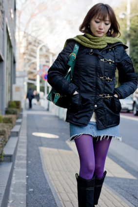 Japanese woman walking down the street (close-up)